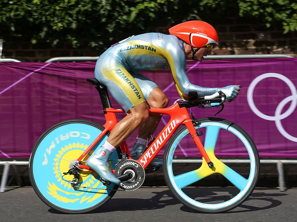 A Cyclist Riding A Bike While Wearing A Skinsuit And An