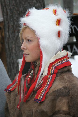Portrait of pretty Sami girl in a traditional hat and peske at the Jokkmokk  Winter Market. Sweden. Size to A4  Sami 99d05520002