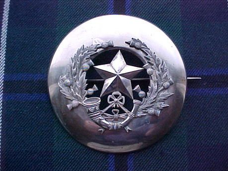 The 1st Bn Cameronians(Scottish Rifles) Piper's plaid brooch.