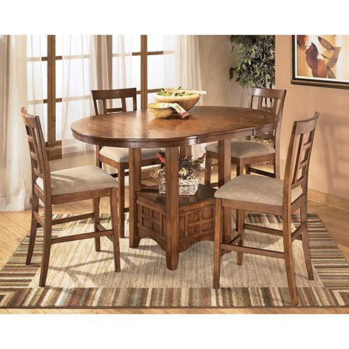 The Ashley Cross Island 5 Piece Dining Room Set Offers A Taste Of