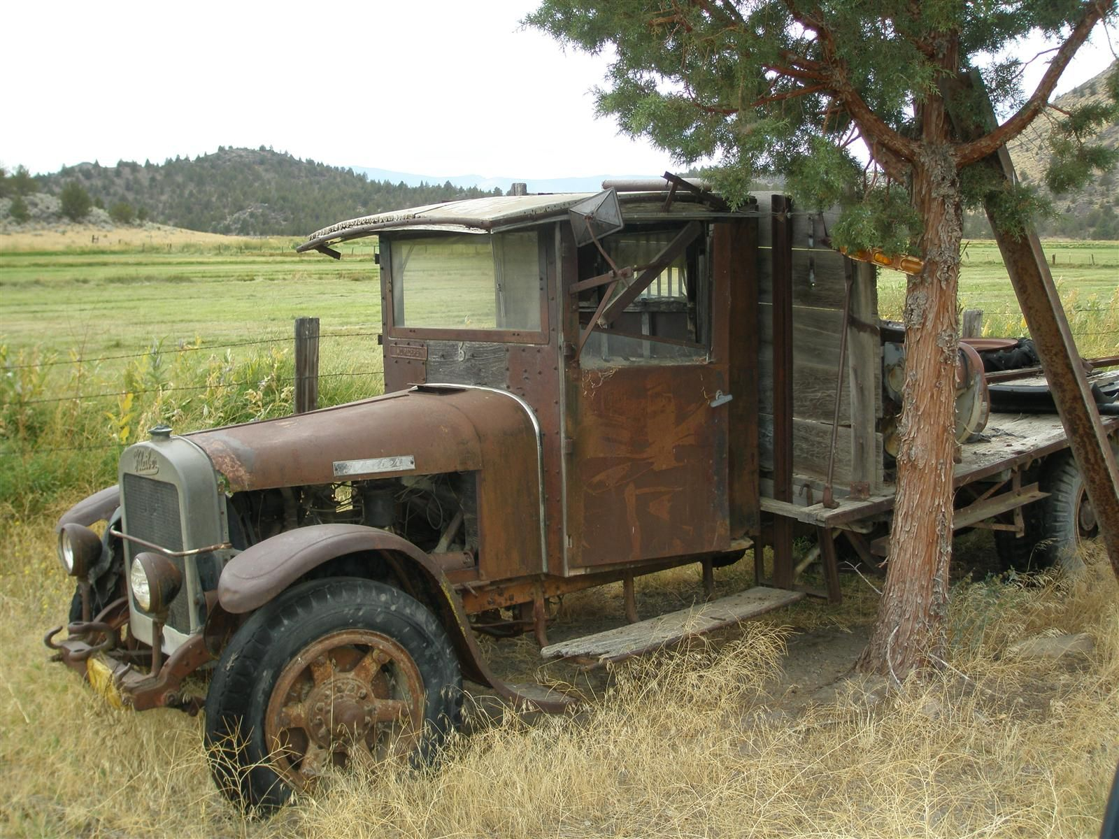 I saw this old truck parked in a field off E. Louie Road near ...