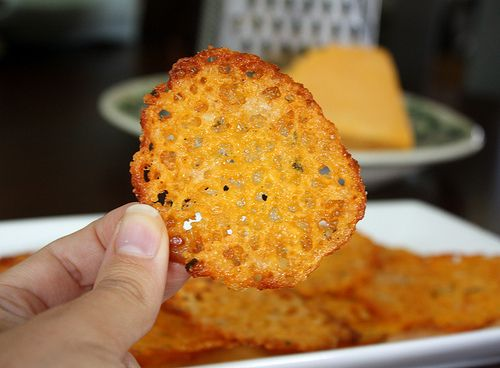 cheese crisps: preheat oven to 350. drop shredded cheese of your choice by the TEASPOON full onto a baking sheet lined w parchment or silicone liner. bake for 5-7 minutes. (can flavor cheese before baking by tossing w a packet of ranch seasoning or Italian herbs. cayenne or red pepper flakes are great w cheddar.) Use dryer cheeses like parmesan or aged cheeses like an aged cheddar or gruyere.