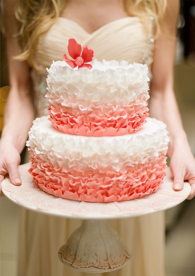 Stunning ruffled pink cake- love the background of the photo!
