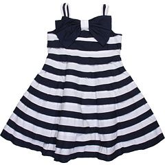 This may be the cutest little-girls' dress in the world. And I may resort to bribery to get at least one of them to wear it.
