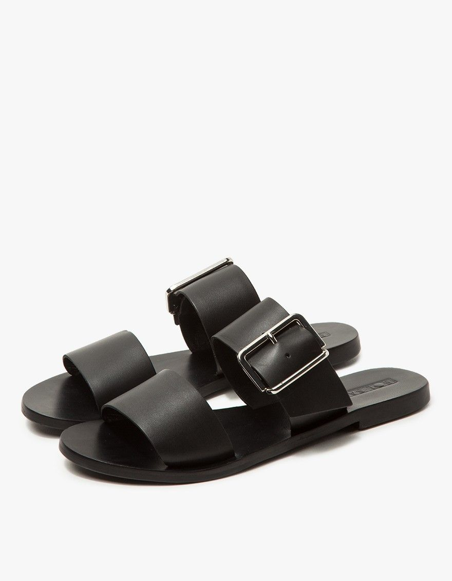 148aaf19bfda Slide sandal from Sol Sana in Black. Wide straps at forefoot. Buckle  adjustment with silver-tone hardware. • Leather upper • Leather lining •  Synthetic sole ...