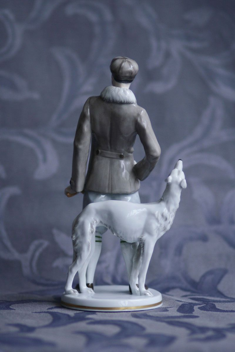 GENTLEMAN WITH BORZOI AUGARTEN Porcelain sculptural group of man with the borzoi is from the Vienna factory Porzellanmanufaktur Augarten. It was designed by sculptor Hanni Gärtner, who made only two statues for this company. These are pendants Lady with shepherd and Man with borzoi. Finely modeled statue is hand painted and gilded, it was created in the year 1925. Marked with blue mark Wien, red Augarten Austria mark and embossed model No. 1526 on the bottom. Excellent condition SOLD