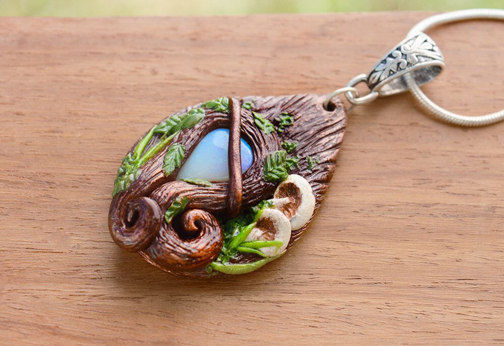 Opal Elf Pendant- handmade fantasy cosplay handmade necklace with leaves and mushrooms by HiddenTreasury12 on Etsy https://www.etsy.com/listing/214756061/opal-elf-pendant-handmade-fantasy