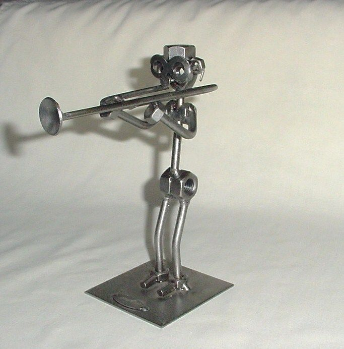 Welded metal nuts and bolts trombone player