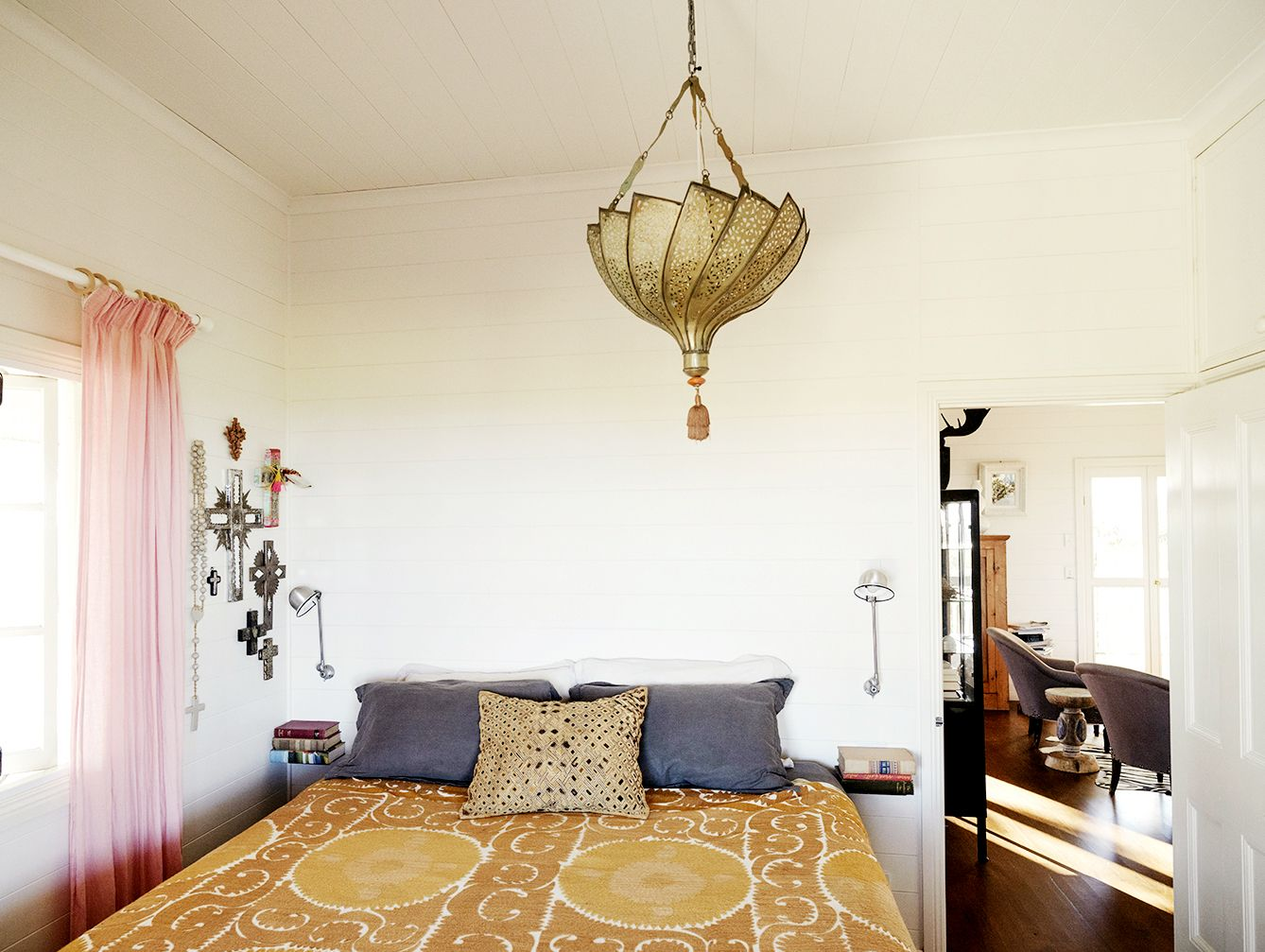 Mustard yellow throw on bed in Moroccan-themed bedroom