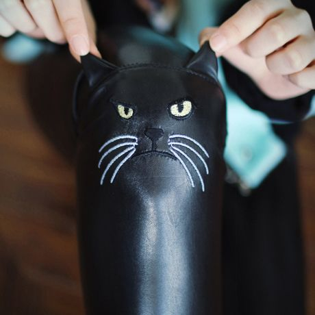 $31.04 leather cat face leggings. @Denise H. H. H. H. grant Granvold I don't know how i feel about this