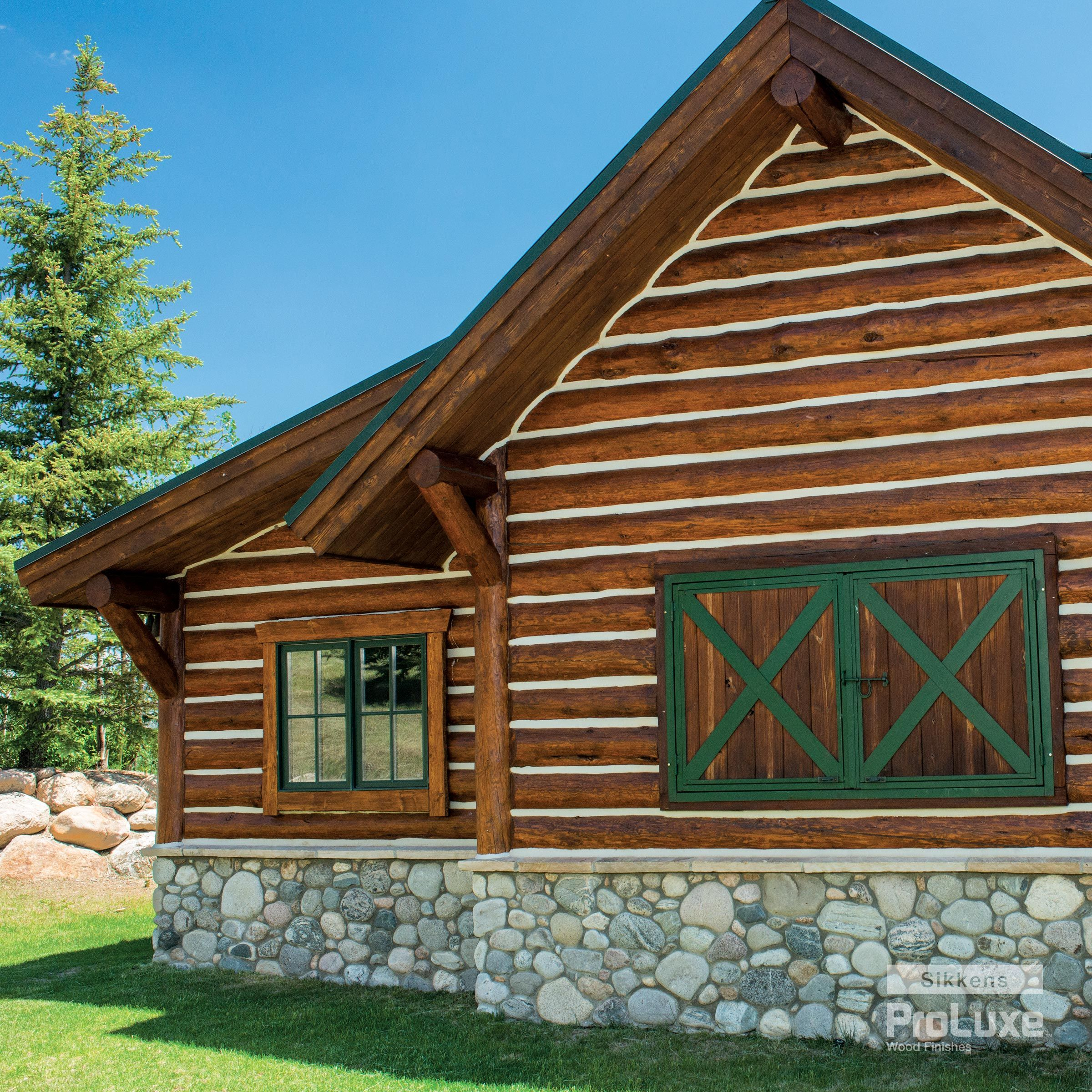 The Rich Wood Tone And Sheen Of This Log Home Were Achieved With Sikkens Proluxe Cetol Log Siding Wood Fin Staining Wood Exterior Wood Stain Exterior Wood