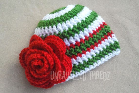 I designed this festive Christmas baby hat for little girls in green and white with a big red flower. Each one is crocheted by me from soft, 100% acrylic yarn and lots of love. ♥ This beanie would be excellent for daily wear, or as a photo prop in your babys holiday pictures. Handmade newborn hats also make wonderful gifts for a baby shower.  SIZES: Newborn: 12- 14 head circumference (30.5- 35.5cm) 0-3 months: 13- 15 head circumference (33- 38cm) 3-6 months: 14- 16 head circumference (35.5…