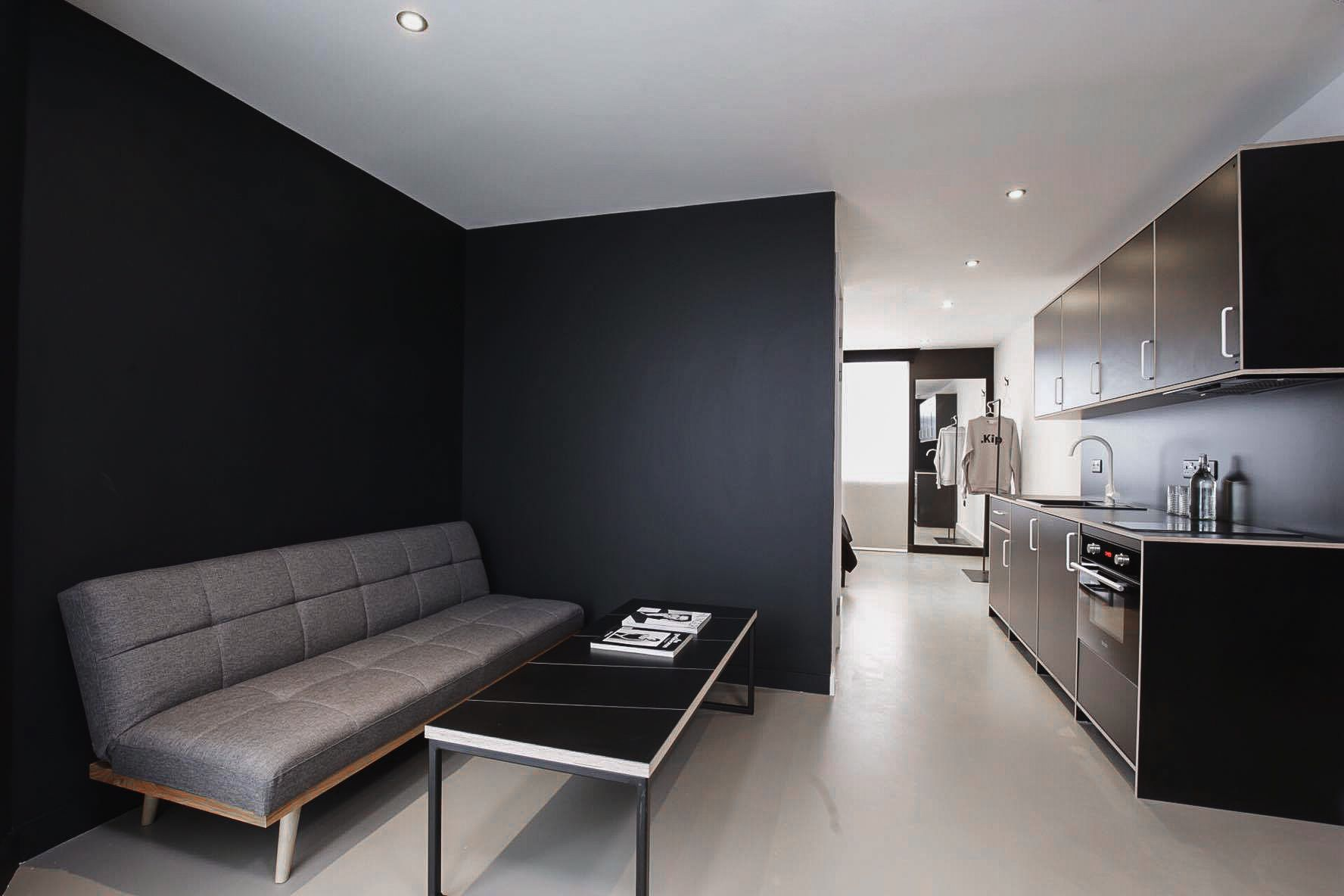 Hotels With Kitchen Ikea Chair Minimalist Monochrome Studio Room In London Hotel King Size Bed And Lounge
