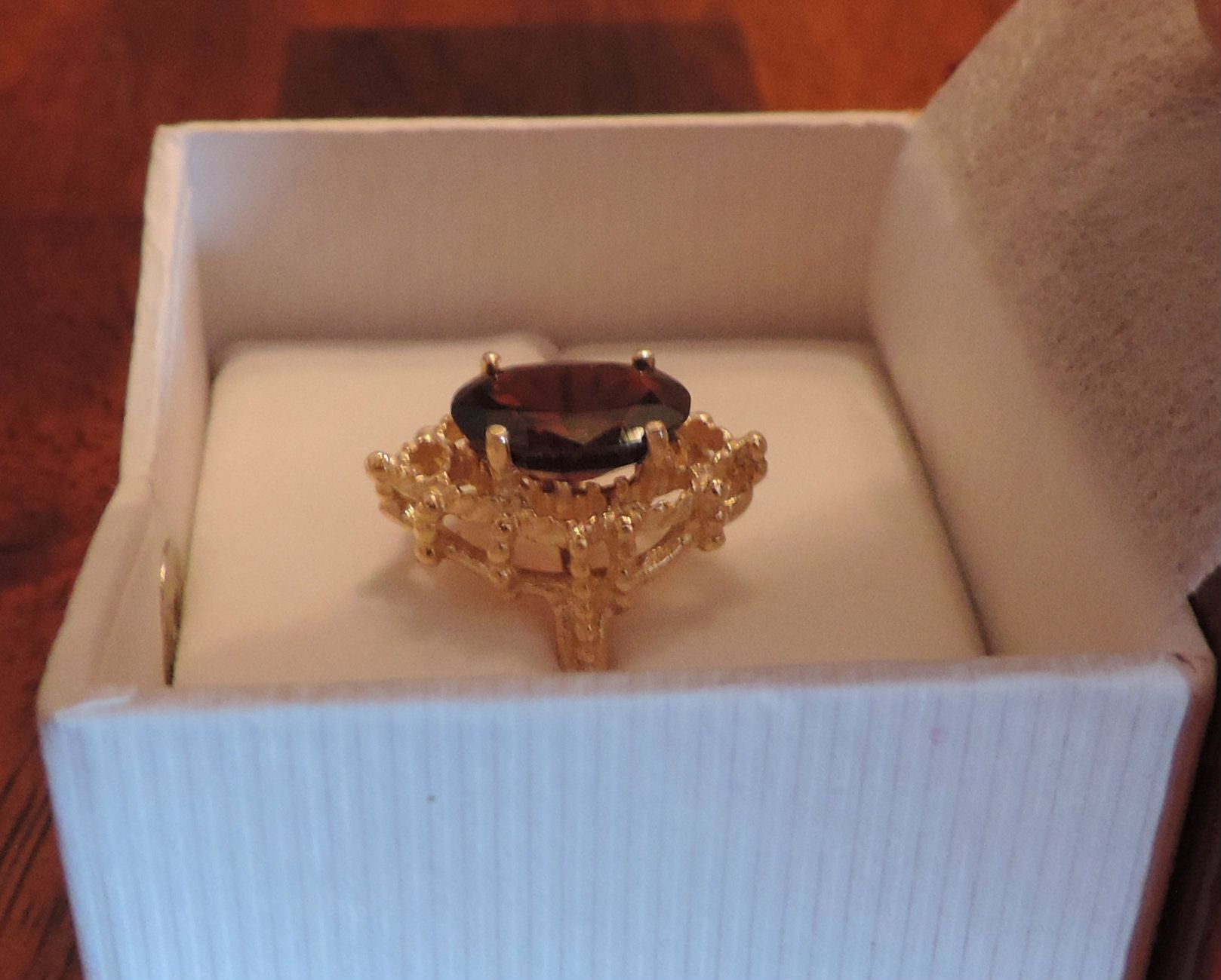 Custom garnet gold ring from Doiron's Jewelry in Red Bud, IL.