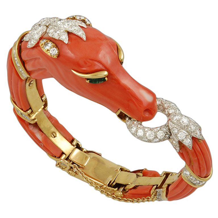 DAVID WEBB Carved Coral Diamond Emerald Horse Bangle, ca. 1980s