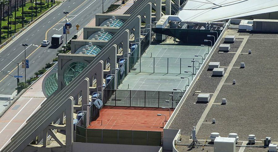 Tennis courts on the roof of the San Diego Convention Center have been closed for years. Downtown residents aren't sure why, but they're pushing to have them reopened. Pictured are three of the six courts.
