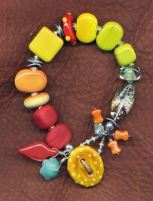 Sizzle Bracelet:  lamp work glass, tagua nut, new and vintage glass