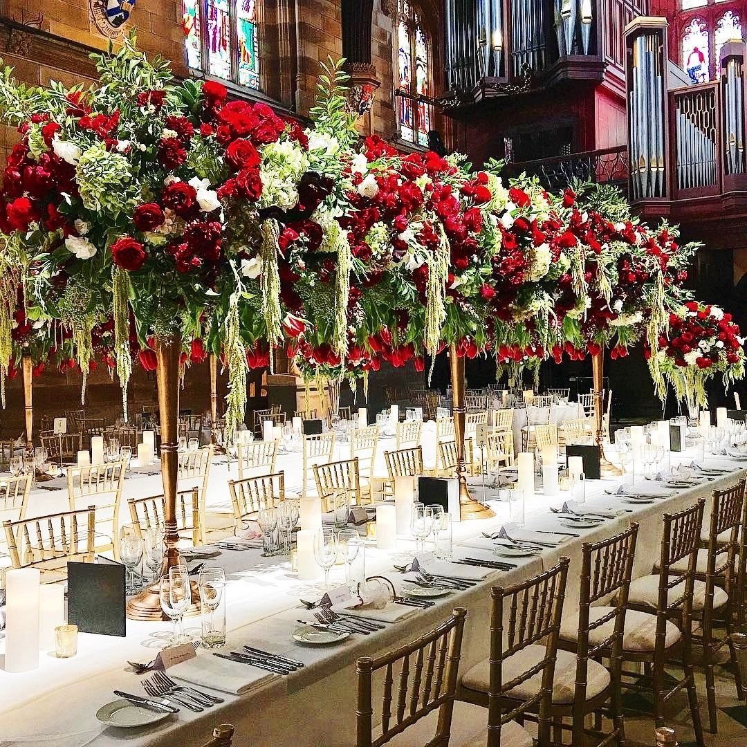Stunning Floral Centre Pieces For A Wedding At The University Of