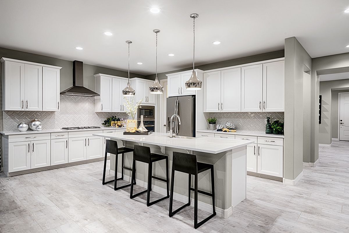 Dark barstools provide contrast in a white kitchen