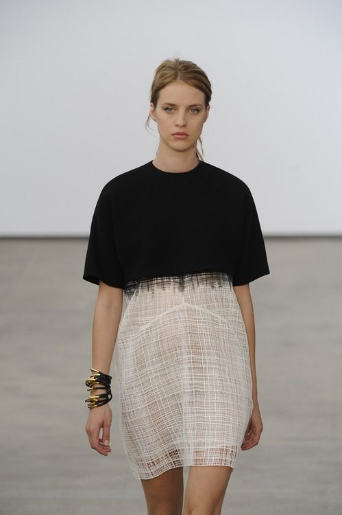 WGSN:A theme of weaving and checks permeated @DerekLamNYC's collection today, we love the ombre effect of this the woven and frayed waistline