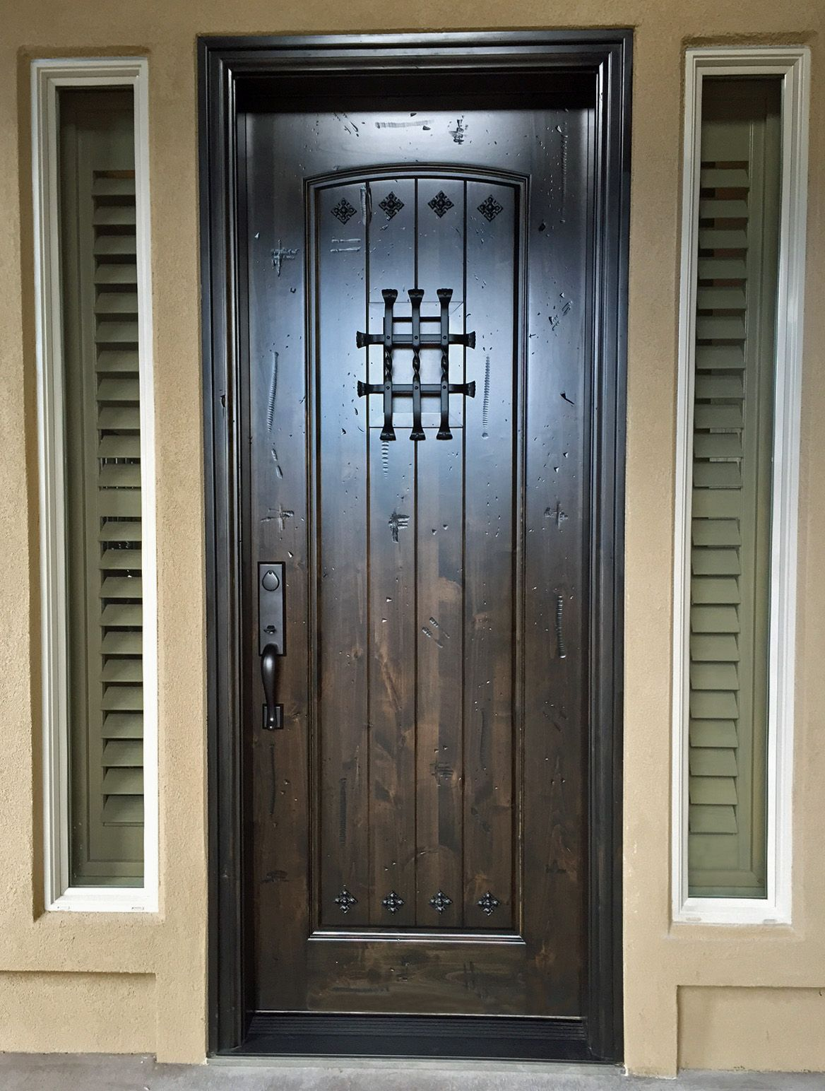 Details create Old World charm in this new knotty alder entry door.speakeasy with grill decorative clavos V-grooves on the raised panel and a highly ... & Details create Old World charm in this new knotty alder entry door ... Pezcame.Com