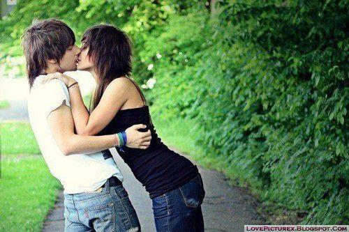 Emo teens kissing