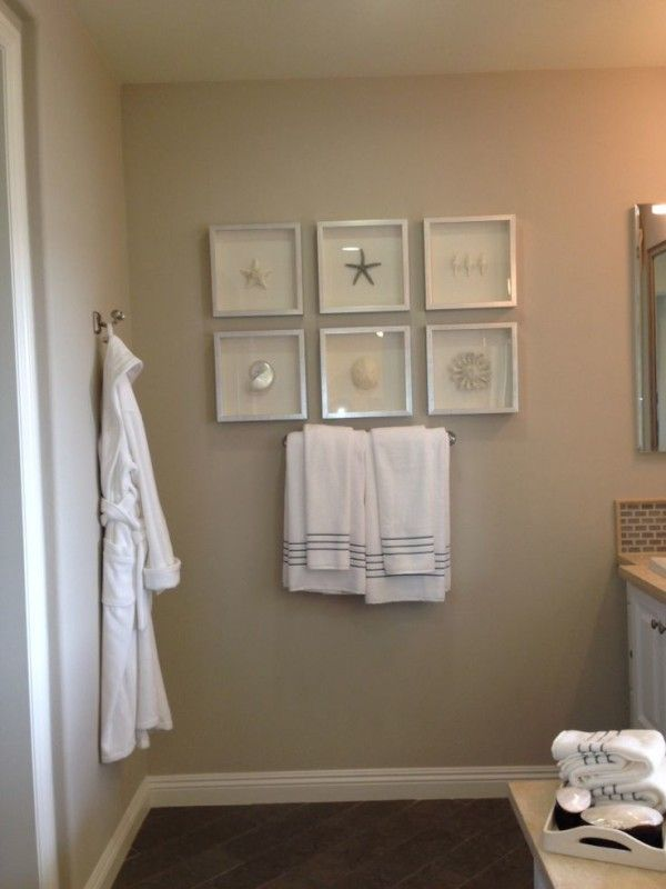 Bathroom Wall Decor Ideas Using White Square Box Picture Frames Above Stainless Steel Towel Bar Alongside
