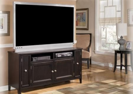 """The Carlyle TV Stand A rich, dark finish accented with satin nickel color hardware adorns this entertainment center creating the perfect example of contemporary furniture. With stylish inset doors and ample storage space within the piers, the """"Carlyle"""" entertainment wall is the perfect addition to any living environment."""