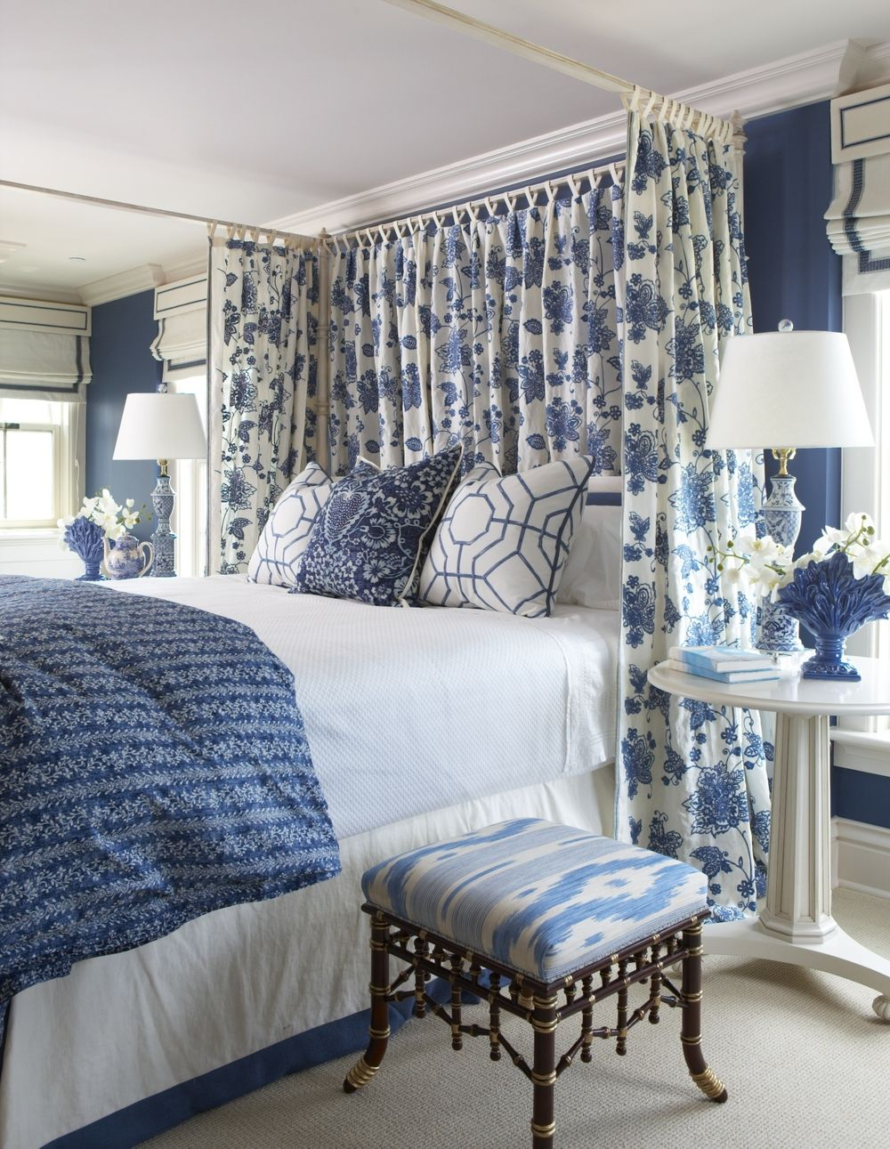 Blue and white master bedroom with floral drapes for a ...