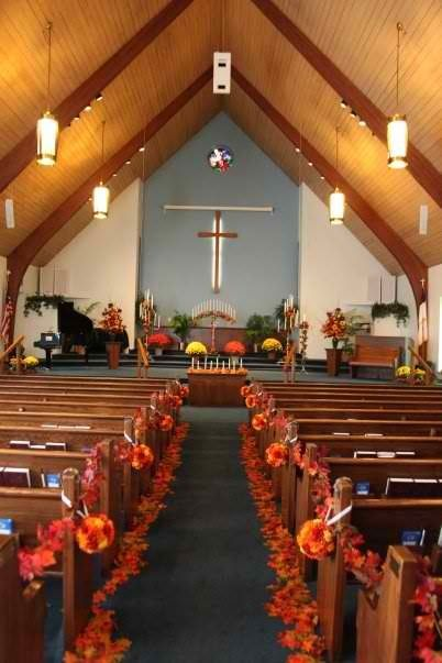 The church - fall wedding maybe without the crazy amount of flowers on the floor but I like the color on the pews