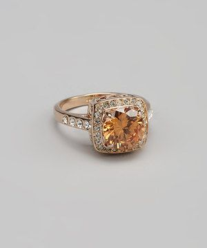 For the perfect combination of luxury and warmth, try a rose gold and SWAROVSKI ELEMENTS cocktail ring. This little accent will add a spark of life to any posh outfit with its elegant design.