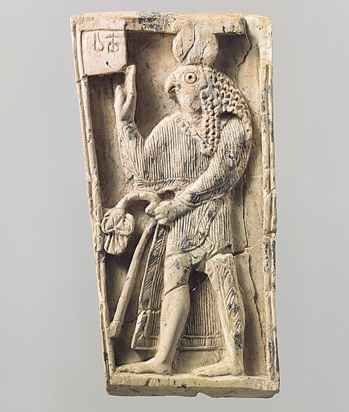 plaque with a falcon headed figure ivory mesopotamia nimrud