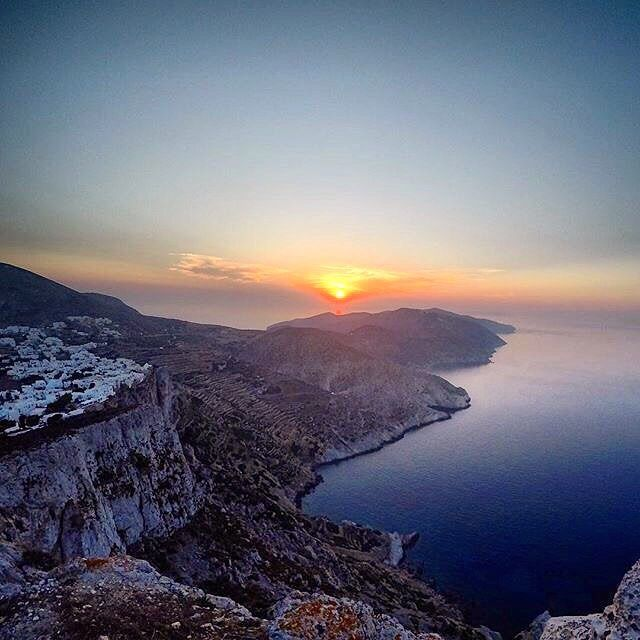 Stunning sunset view over the Aegean Sea , at Folegandros island ( Φολέγανδρος ) . Magical wild landscapes and impressive Cycladic atmosphere .... !
