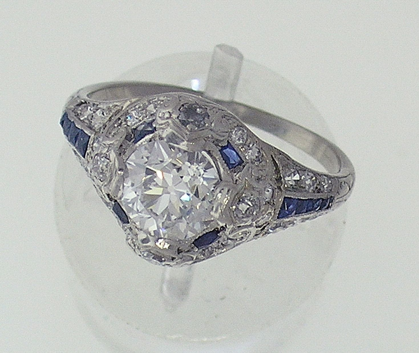 Art Deco Platinum Diamond & Sapphire Engagement Ring 1.01cts E color VS1 clarity. .