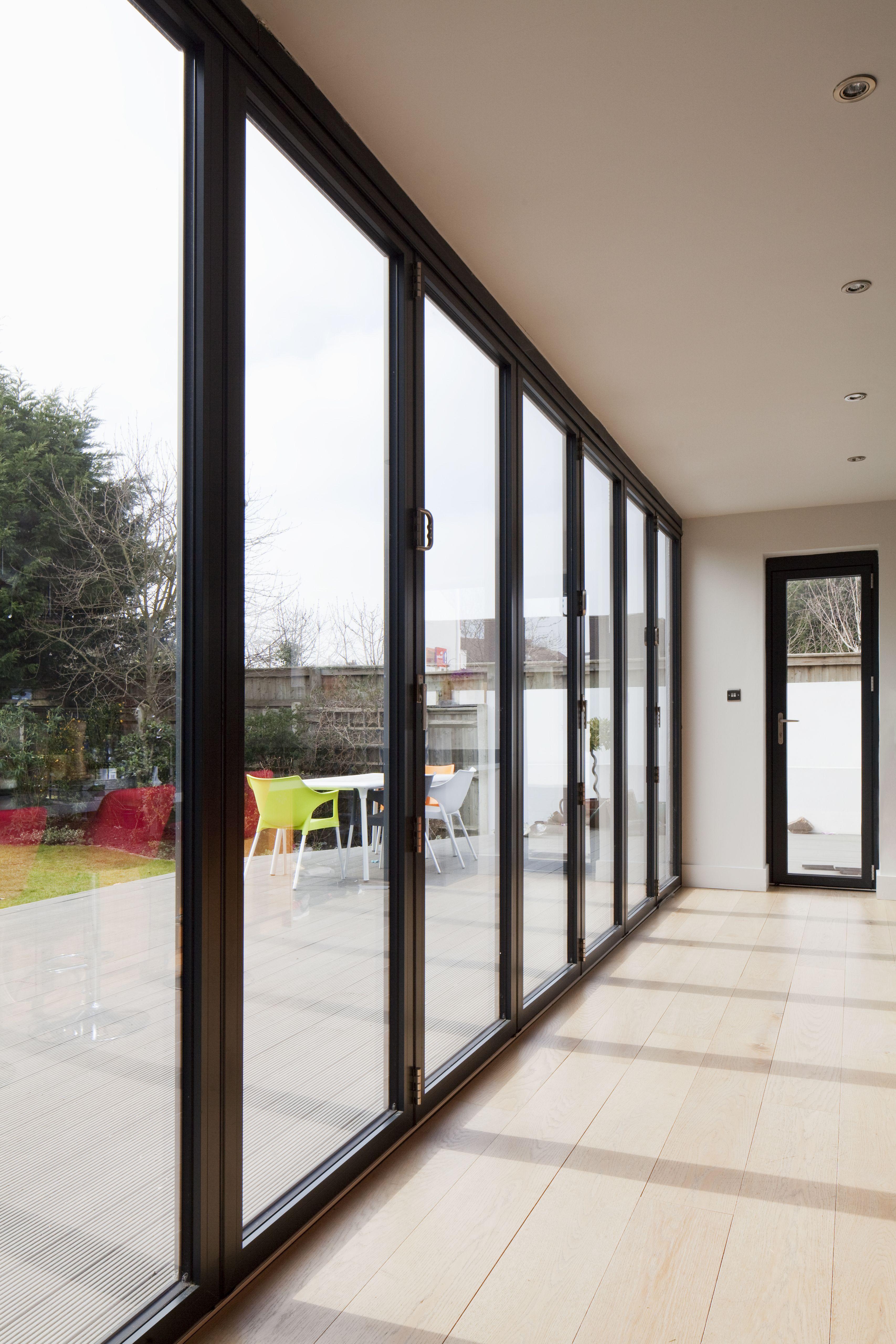 Floor to ceiling contemporary grey aluminium bi-fold doors | modern ...