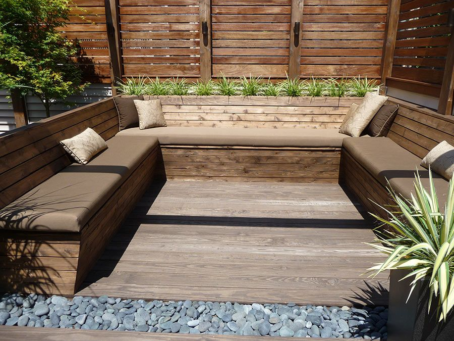 Extremely Fascinating Rooftop Deck Narrow U Shaped Brown Bench With Decorative Cushions Set On