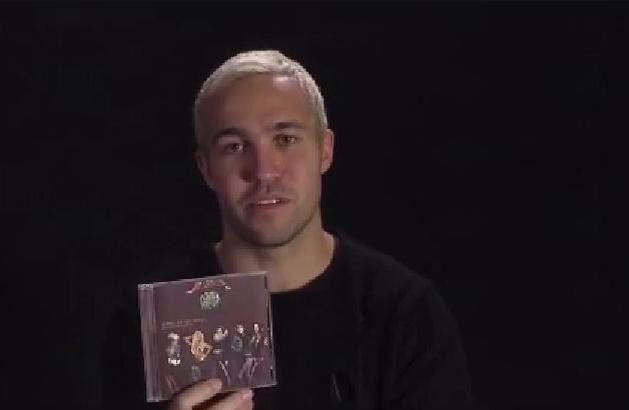 Pete Wentz holding a piece of musical history in his hands