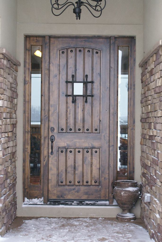 This eto door is a great way to add an antiquated feel to for Big entrance door