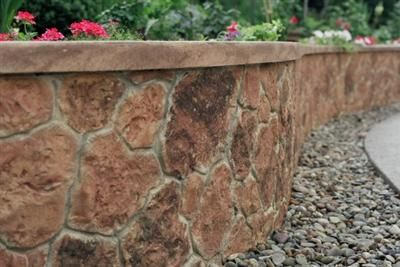 This Concrete Wall Was Stamped Hand Carved And Stained Retaining Wall Design Retaining Wall Concrete Retaining Walls