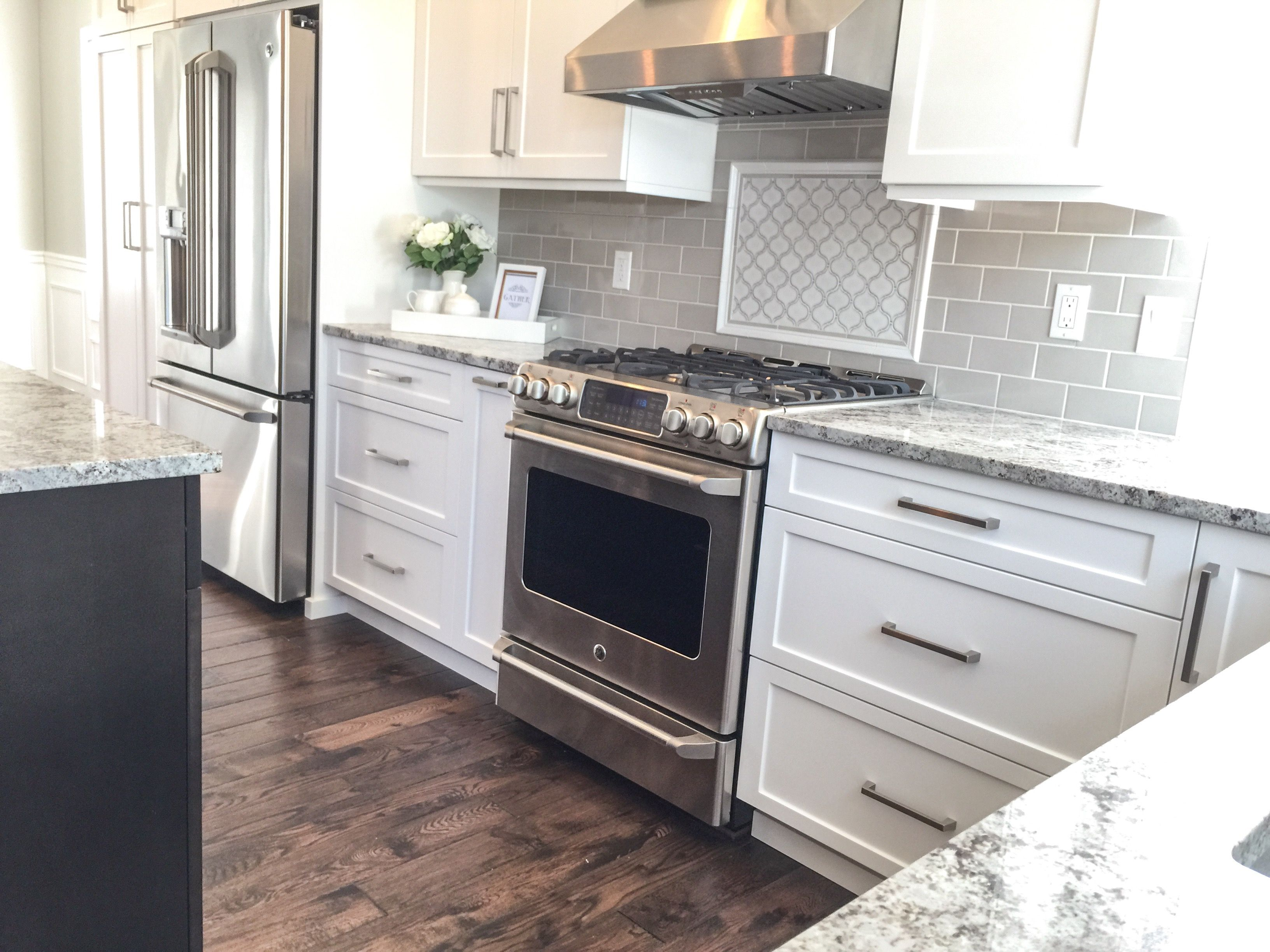 Kitchen Remodel White Shaker Cabinets With Dark Stained Island Two Toned Transitional Kitchen With Tile Kitchen Remodel Home Decor Kitchen Beautiful Kitchens