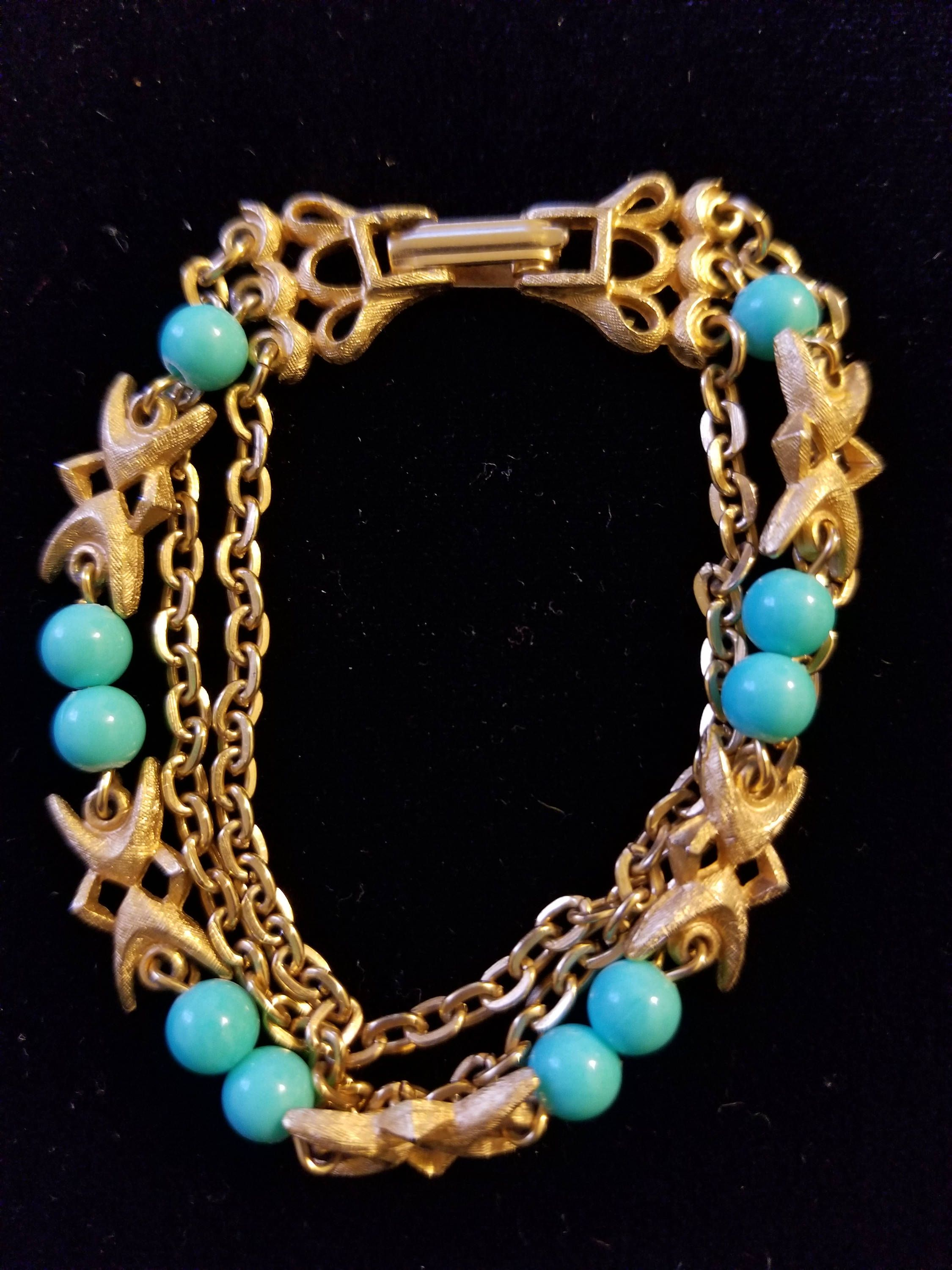 1b7fa16ad86f9 Turquoise and gold toned bracelet. Vintage colored beads and two ...