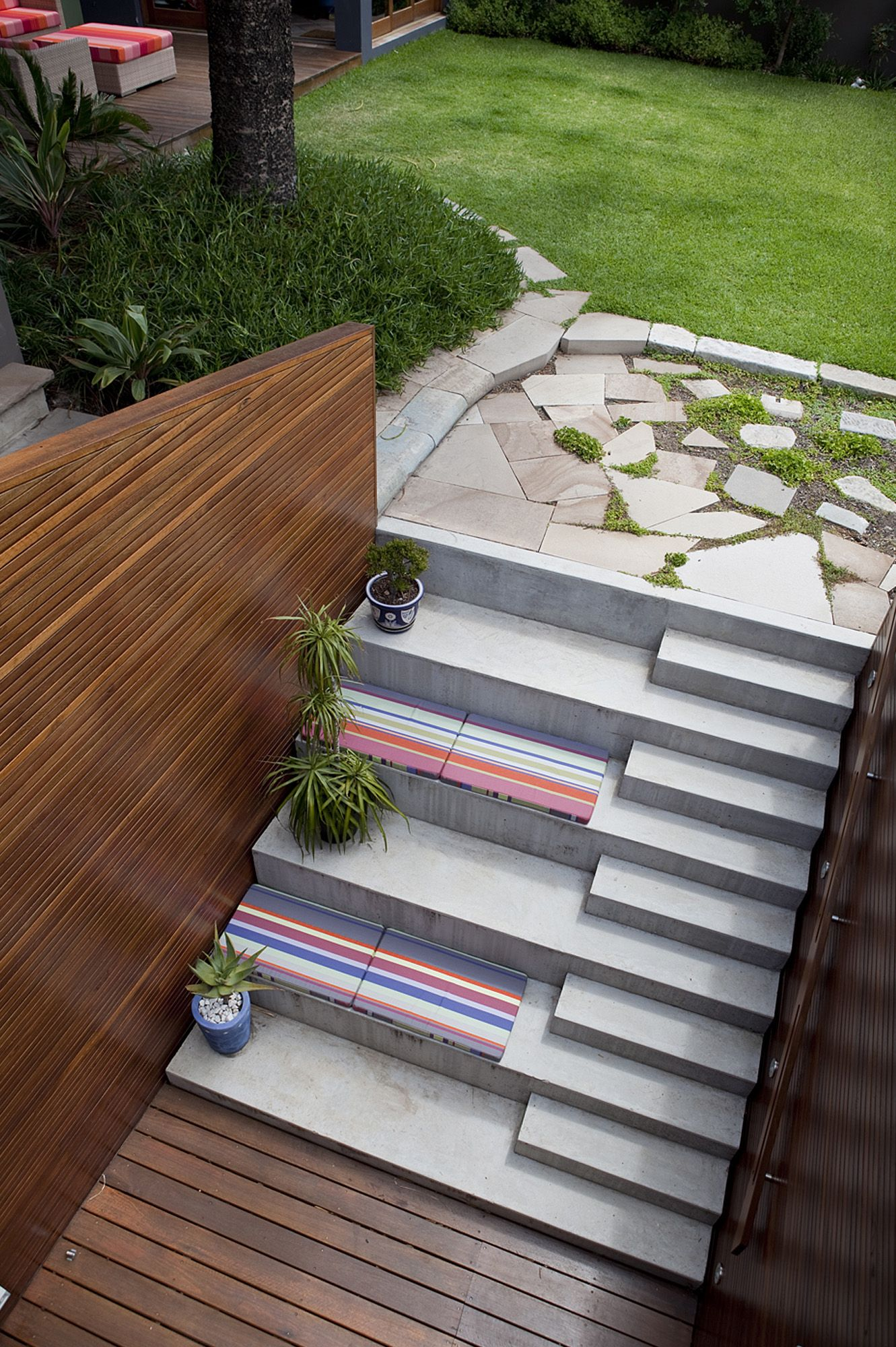 Patio stairs benches opposite an outdoor movie screen would be