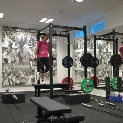 love the wall of bw pictures in this home gym  fitness