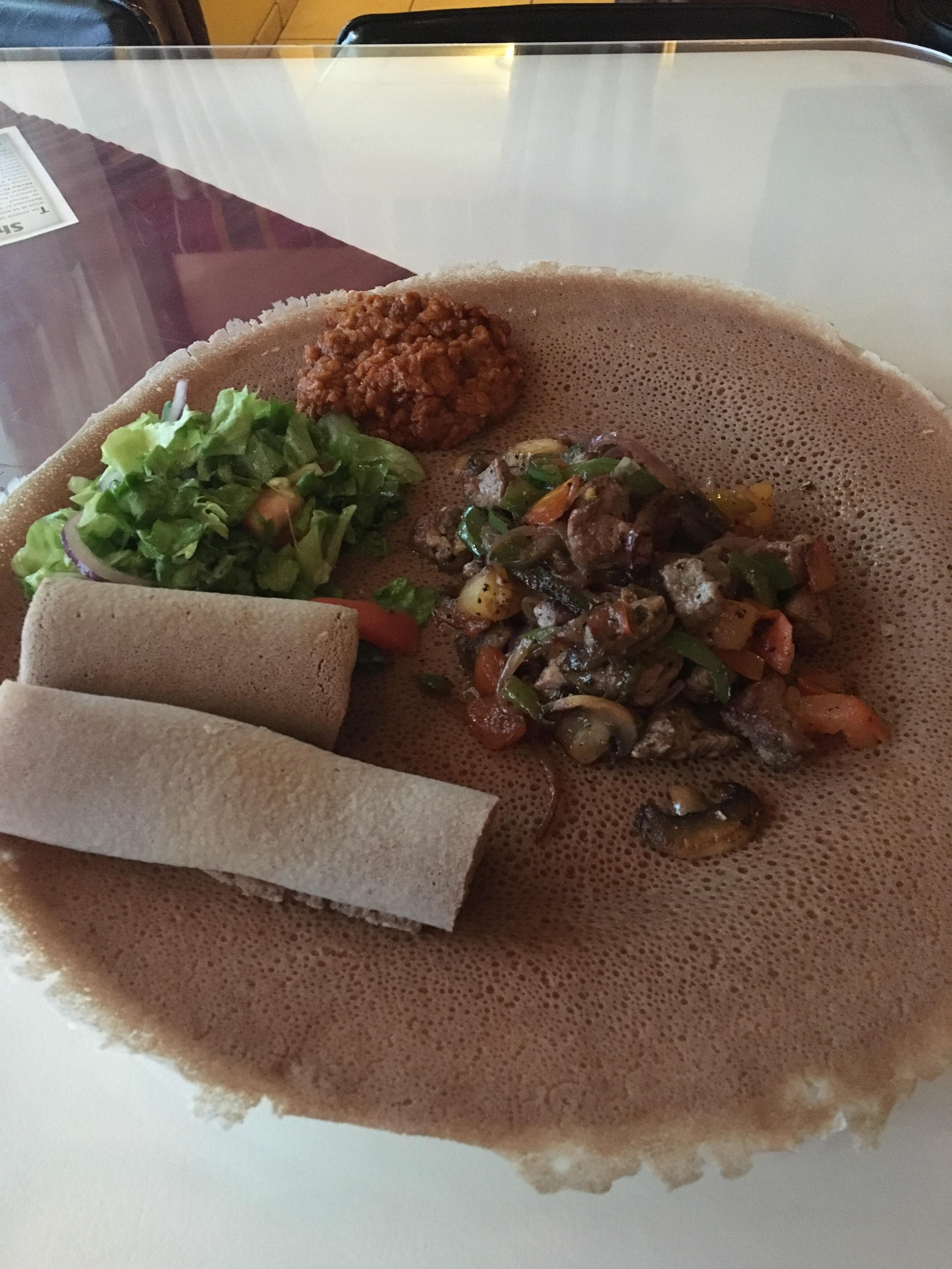 [I ate] Ethiopian Shifta tips (lamb) kik wot (lentil stew) injera (flat bread) and side salad
