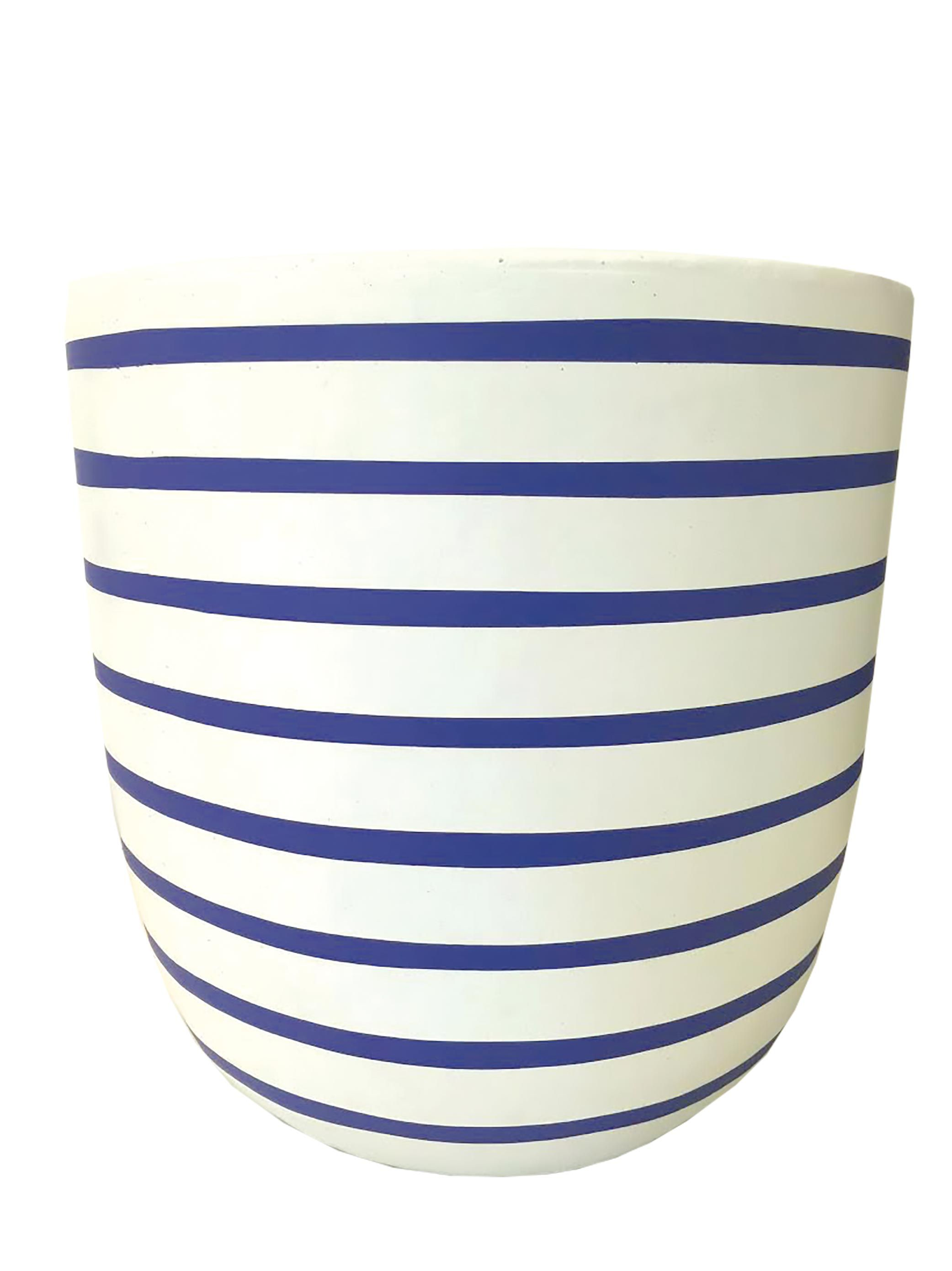 This Pinstripe pot in electric blue from Design Twins creates a Palm Springs style.