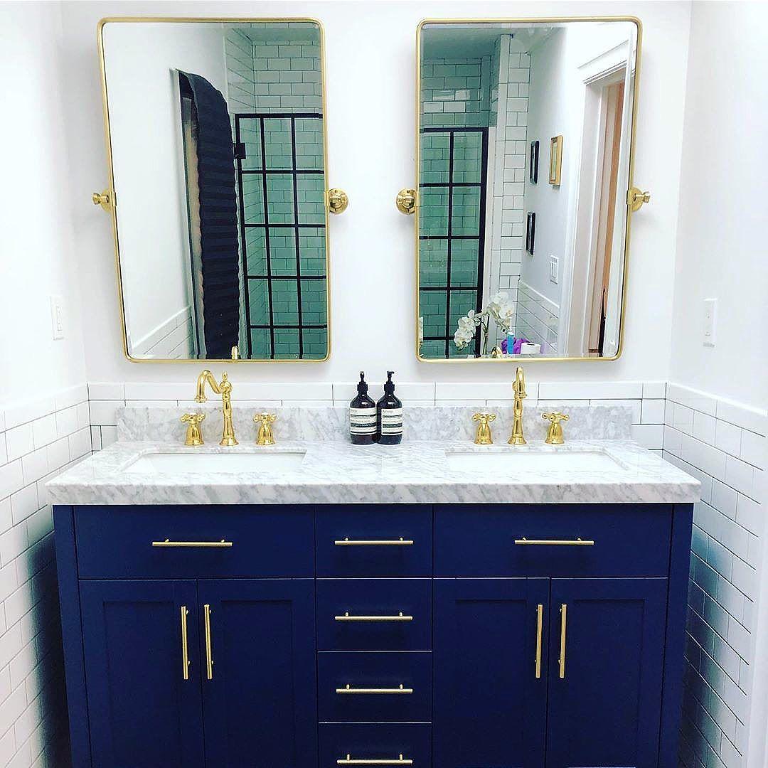 The Bright White Paint In The Bathroom Keeps The Space Feeling Fresh And Clean Paint Color Is Fresh Kicks Bathroom Vanity Small Bathroom Blue Bathroom Vanity
