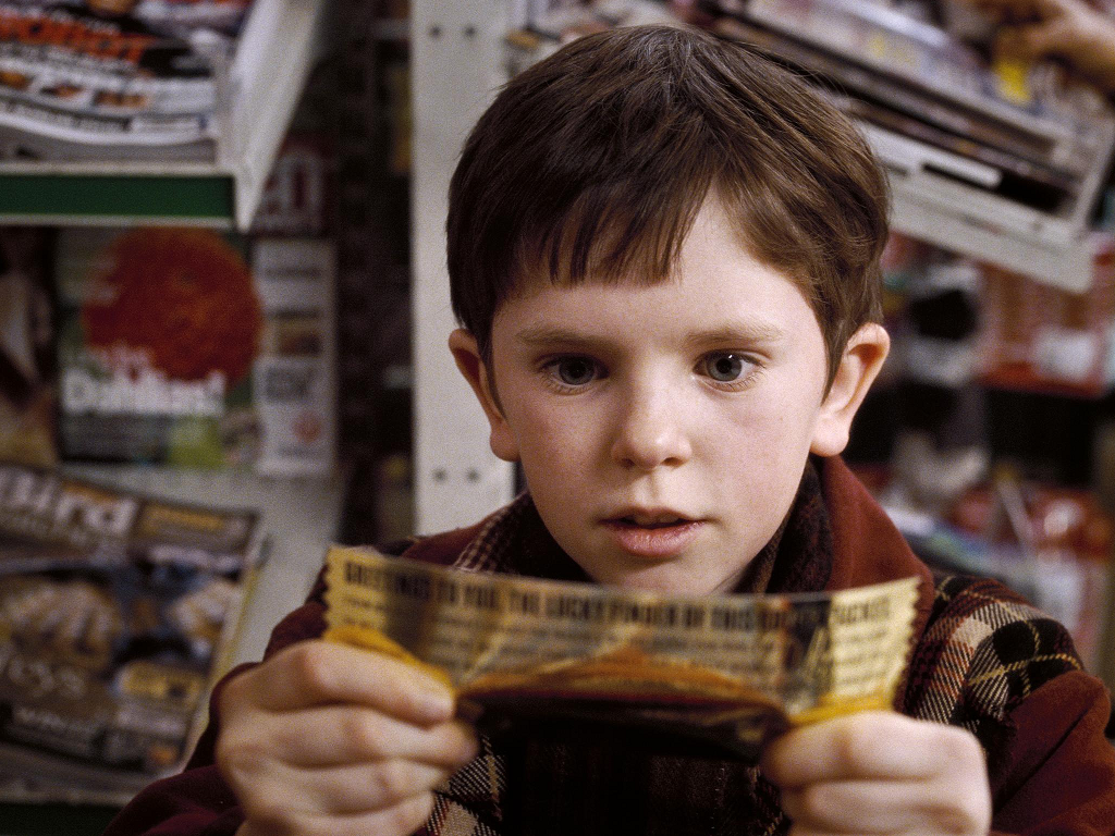 Charlie bucket lives in a poor family. Every year he gets a bar of ...