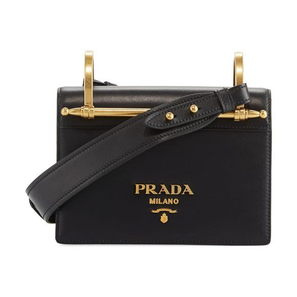 cb72c7bf988d24 Pionerre Small Flap Crossbody Bag by Prada. Prada leather shoulder bag with  bar detail. Removable, padded curb-chain strap. Flap top with magnetic snap  ...