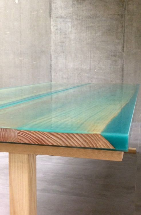 A close-up of the Iro table by Jo Nagasaka reveals the intermingling of the resin and timber materials and the contrast of polished transluc...