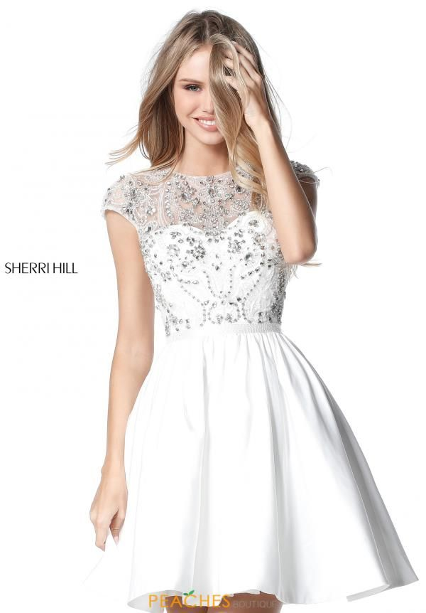 Short and sweet this lovely Sherri Hill dress 51515 makes the perfect homecoming  dress. The dress showcases a high neckline with cap sleeves along with .